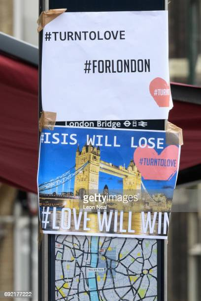 Posters reading 'ISIS Will Lose Love Will Win' are seen on a map of the area following last night's London terror attack on June 4 2017 in London...