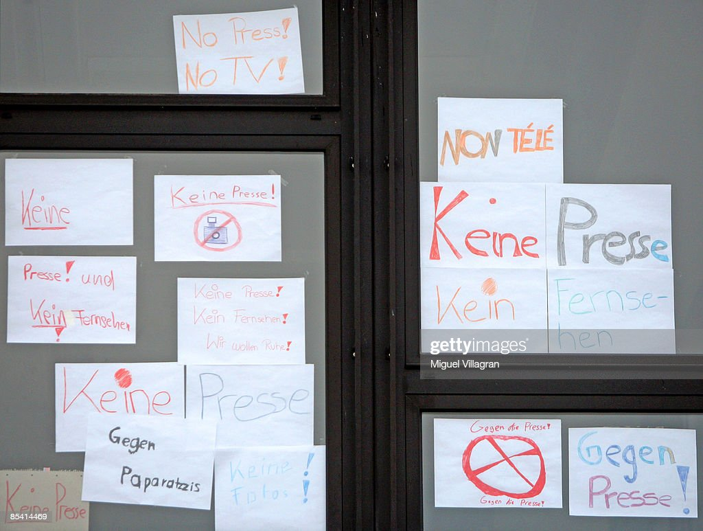 A posters reading 'No press' are pictured in a window of a high school next to the Albertville School Centre on March 13 2009 in Winnenden Germany17...
