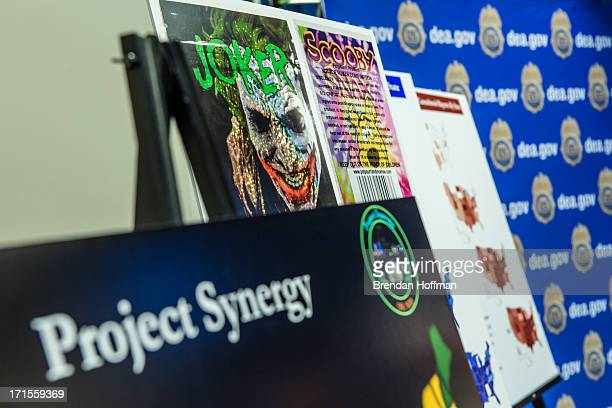 Posters showing a sample of synthetic drugs are displayed during a news conference at Drug Enforcement Agency headquarters on June 26 2013 in...
