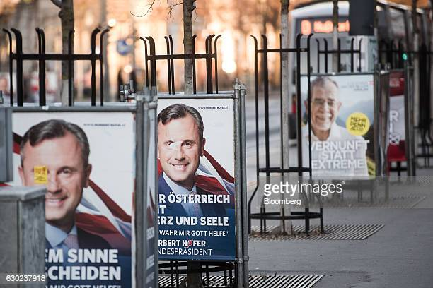 Posters showing the faces of Norbert Hofer presidential candidate of Austria's Freedom party and Alexander Van der Bellen presidential candidate of...