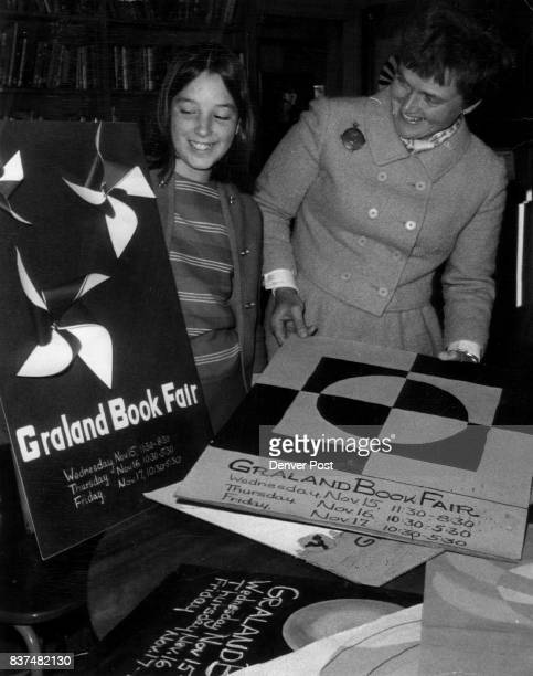 Posters Tell of Christmas Book Sale Graland student Emmy Bunker looks over posters of Graland Country Day School Book Fair with Mrs Philip Emery...