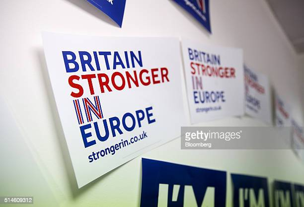 Posters with campaign logos sit on a wall at the Britain Stronger In Europe campaign offices in London UK on Thursday March 10 2016 The Britain...