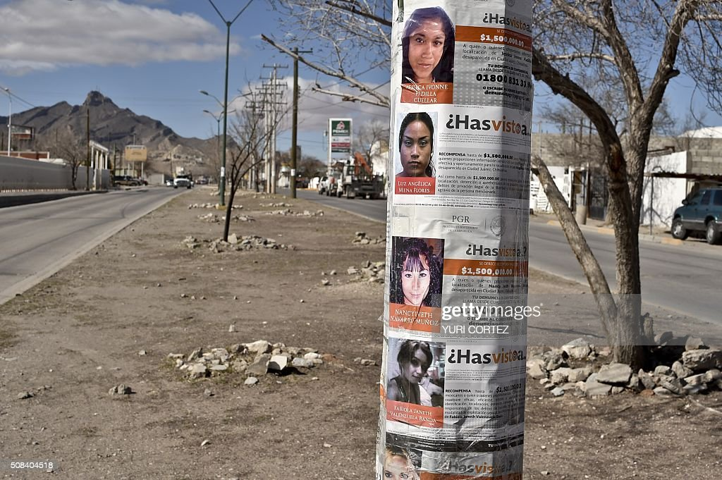 Posters with images of missing girls are on a post in a street of Ciudad Juarez Mexico on February 2 2016 Hundreds of mothers who look for her...