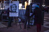 Posters with photos of Deah Shaddy Barakat his wife Yusor AbuSalha and her sister Razan AbuSalha at a vigil on the campus of North Carolina State...
