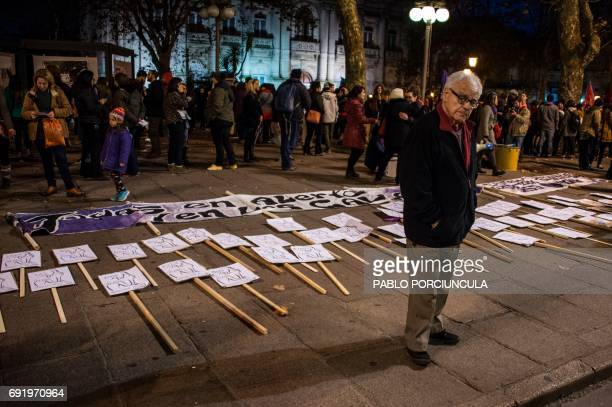 Posters with the names of women victims of feminicide are displayed at Plaza Libertad before a march under the slogan 'Not One Less' against gender...
