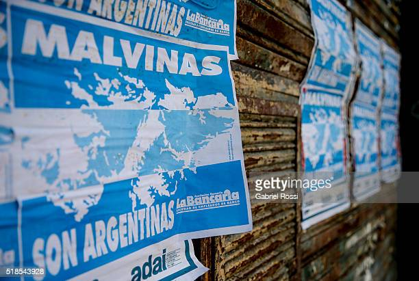 Posters with the shape of Malvinas Islands reading 'Malvinas are Argentine' on March 31 2016 in Buenos Aires Argentina On April 02 1982 Leopoldo...