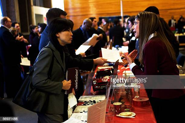 A postgraduate student at Rutgers University speaks with a representative from a financial services and investment banking company during a job fair...