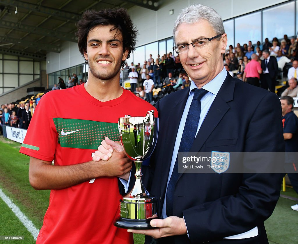 Postiga of Portugal is presented with the trophy during the match between England U17 and Portugal U17 at Pirelli Stadium on September 2, 2012 in Burton-upon-Trent, England.