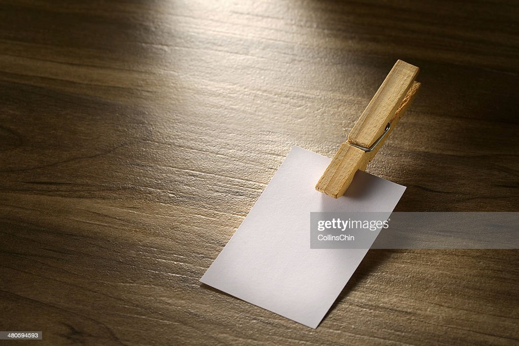 Post-it Note with wooden clip : Stock Photo