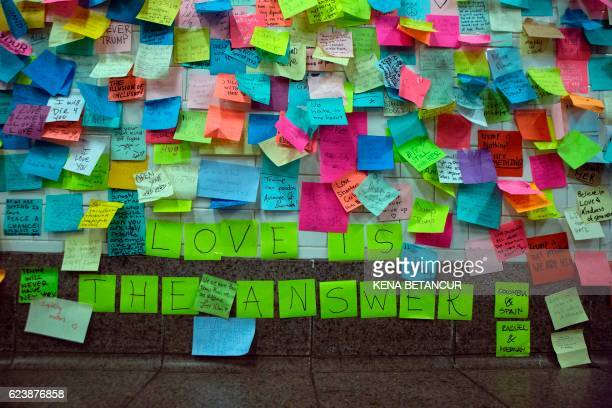 TOPSHOT Postit notes are viewed as part of the art piece 'Subway Therapy' at the Union Square subway station in New York on November 17 2016 'Subway...