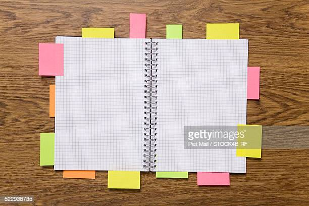 Post-its attached to notebook