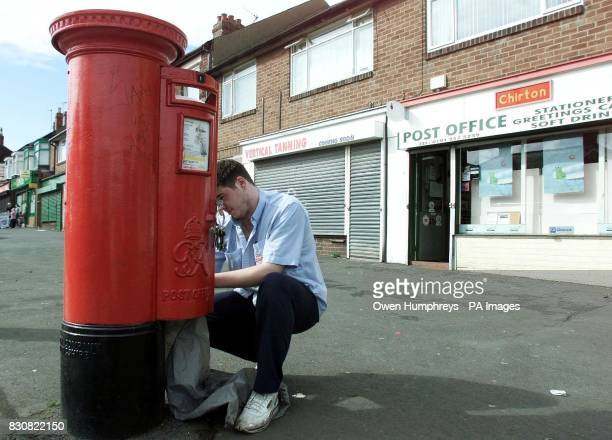 A postman collects the morning mail in North Shields Newcastle Consignia has announced the loss of 15000 postal jobs as the company tries to recover...