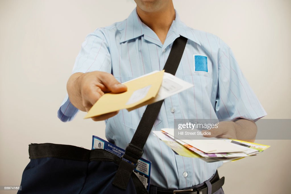 Postman delivering mail : Stock Photo