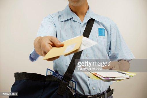 Postman delivering mail : Foto de stock