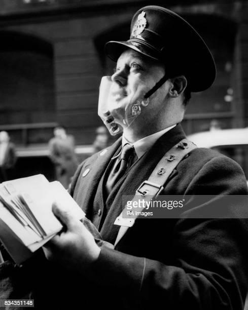 Postman John Whitwell tries out the new opentop smog mask so he can avoid the smoke and smog pollution of the city