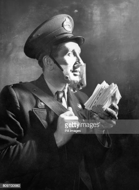 Postman Robert Baker tests a new featherweight opentop smog mask At the bottom of the mask is a small plastic tube that releases small amounts of...