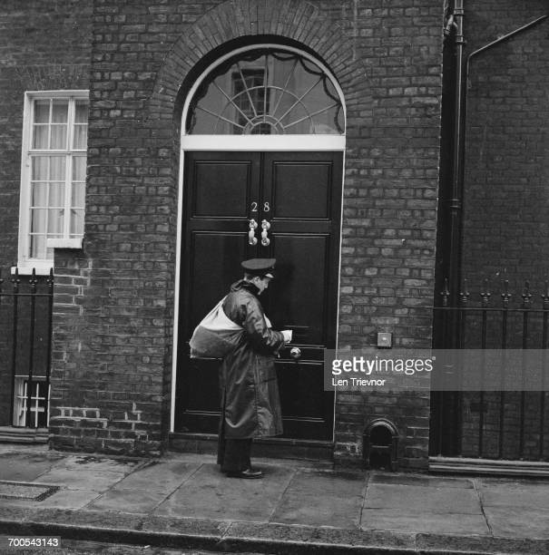 A postman stops at 28 Hyde Park Gate in London the home of Winston Churchill 17th November 1960