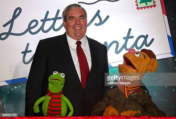 Postmaster General and CEO John E Potter with Kermit the Frog and Fozzie Bear attends the US Postal Service and the Muppets 'Letters To Santa' kick...