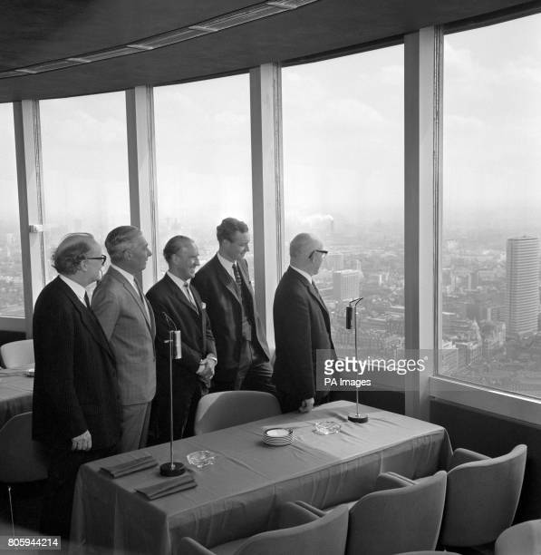 PostmasterGeneral Anthony Wedgwood Benn showing the futuristic new GPO Tower to former Postmaster Generals He entertained them to lunch in the...