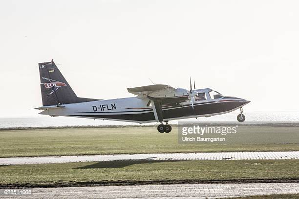 Postseason on the North Sea Island of Juist Propeller aircraft of the company Frisia while approaching the airfield of Juist