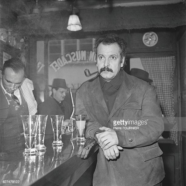 Postwar French singersongwriter Georges Brassens is famed for his songs Le Gorille and Les Copains 'D'Abord Brassens smoking a pipe in a cafe
