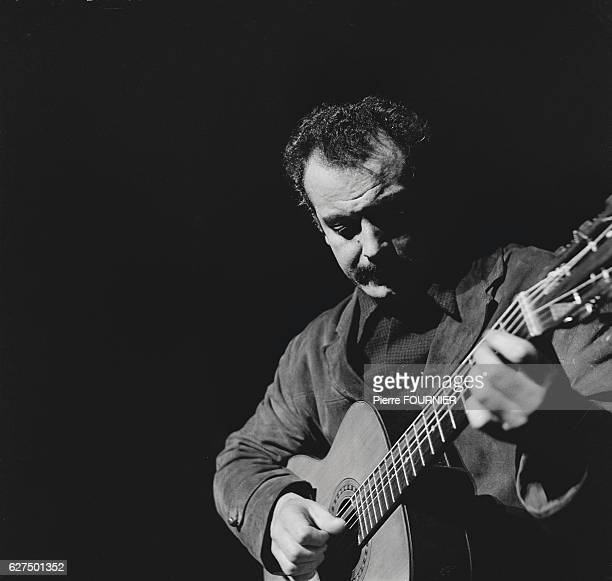 Postwar French singersongwriter Georges Brassens is famed for his songs Le Gorille and Les Copains 'D'Abord Brassens playing guitar