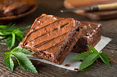 Delicious homemade pot brownies with marijuana leaf garnish.