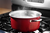 Pot of boiling water on stove top