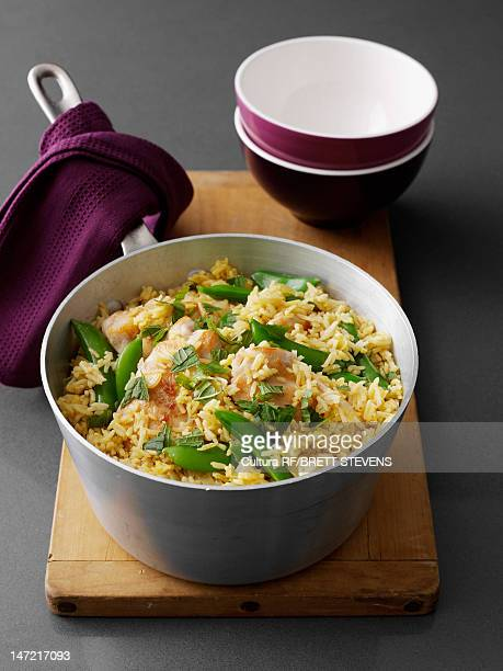 Pot of chicken and rice on board