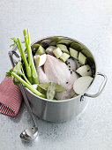 Pot of chicken and vegetables for stock