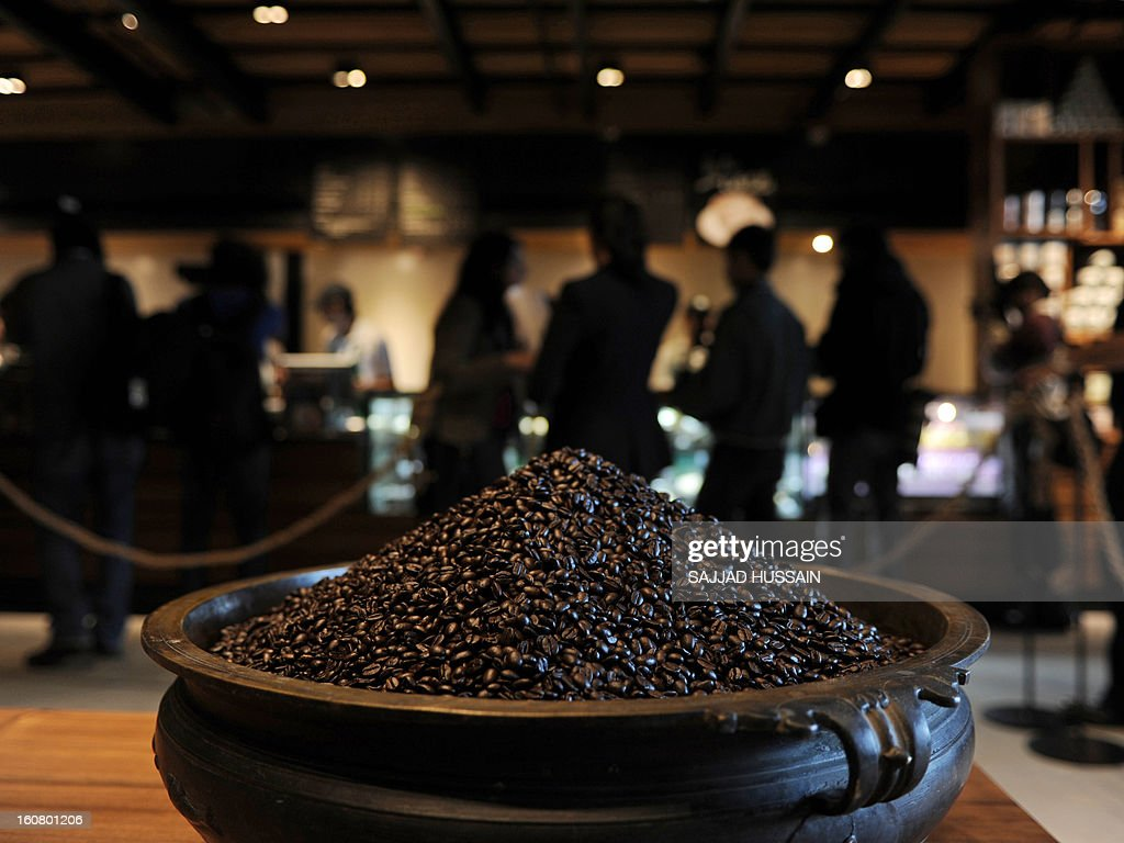 A pot of coffee beans are pictured as customers gather at the newly-inaugurated Starbucks outlet in New Delhi on February 6, 2013. Starbucks, the world's biggest coffee chain, launched its first outlet in New Delhi on Wednesday with an aim to expand its reach to customers across India. AFP PHOTO/ SAJJAD HUSSAIN