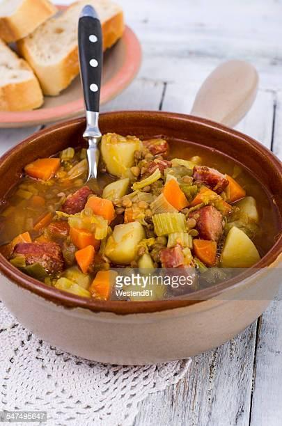 Pot of lentil soup with sliced minced pork sausage