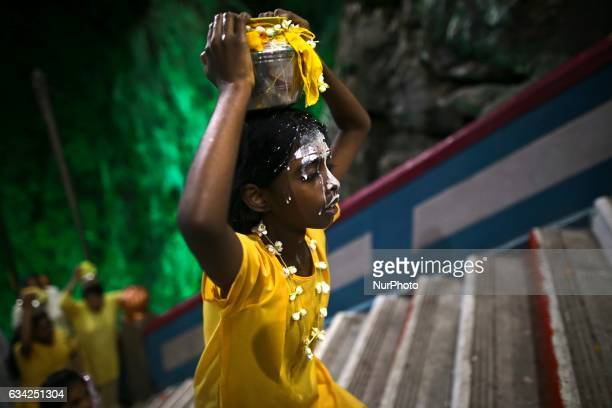A pot of milk carried by a young Hindu devotee spilled as she made way up towards the Batu Cave to make offerings in Kuala Lumpur on February 8 2017