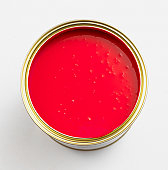 Pot of red paint, overhead view