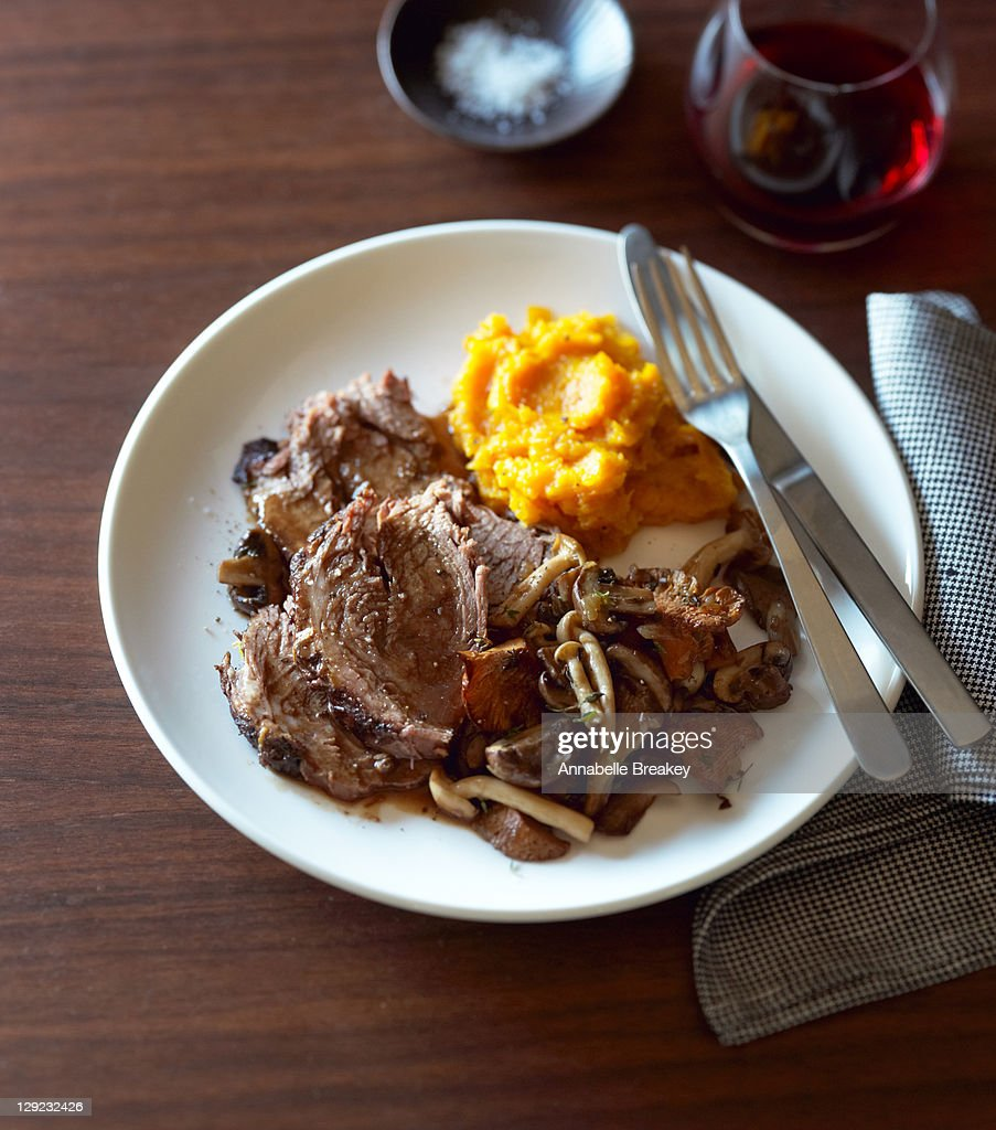Pot roast, wild mushrooms, mashed butternut squash : Stock Photo