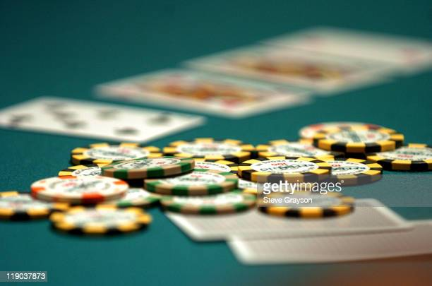 A pot sits on the gaming table as the 'River Card' is to be dealt during day one of the World Poker Tour's Doyle Brunson North American Poker...