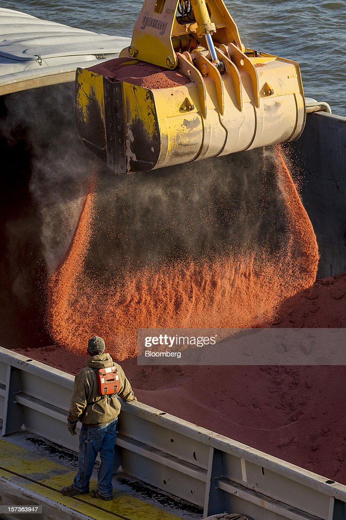 Potash is unloaded from a river barge at the Growmark Inc.'s Bussen Terminal along the Mississippi River in St. Louis, Missouri, U.S., on Friday, Nov. 30, 2012. The rush is on to keep customers supplied, workers employed and commerce alive in communities that rely on the nation's busiest waterway. The usual dry season, combined with the worst drought in 50 years, may push water levels so low in coming weeks it will halt traffic in a section south of St. Louis, near the river's midpoint. Photographer: Whitney Curtis/Bloomberg via Getty Images