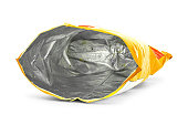 Potato chips bag isolated on white background. Inside of leftovers snack packaging.