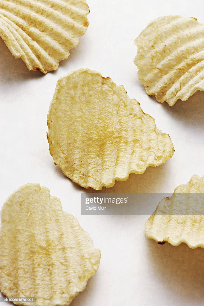 Potato chips, studio shot : Stock Photo