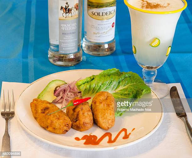 Potato dish and Pisco Sour both served in a traditional Peruvian restaurant owned by an immigrant family in the city