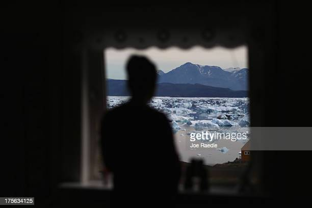 Potato farmer Arnaq Egede looks out the front window of her home on July 31 2013 in Qaqortoq Greenland The farm the largest in Greenland has seen an...