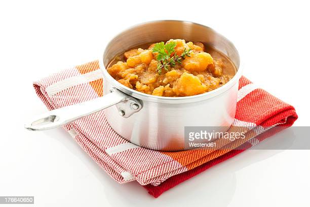 Potato goulash with sausage in saucepan, close up