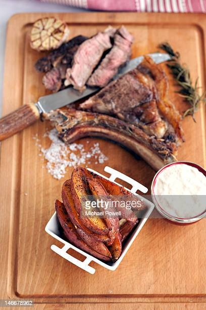 Potato wedges with panfried rib of beef and horser