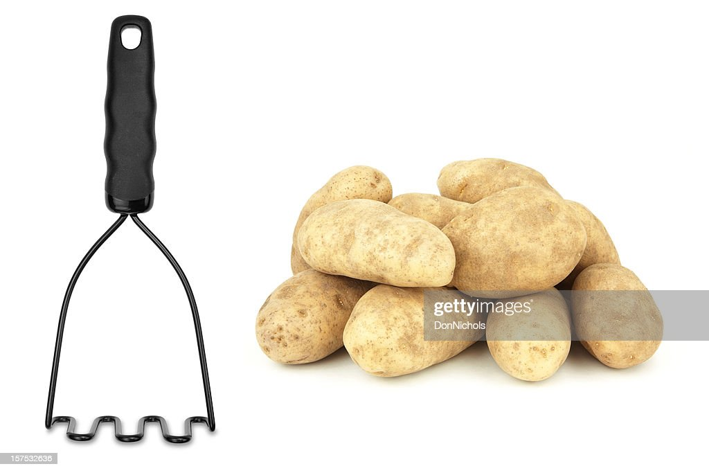 Potatoes and Masher Isolated