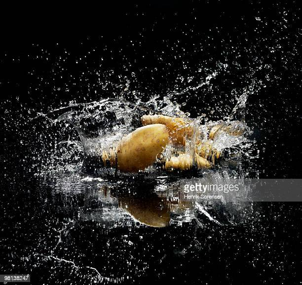 Potatoes in splashing water