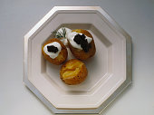 Potatoes in their Skins Topped with Sour Creme and Caviar