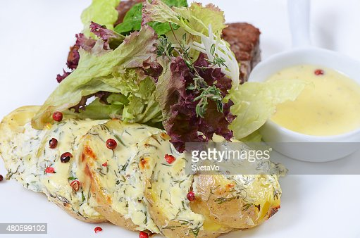 Potatoes with meat in cream sauce with pepper : Stock Photo
