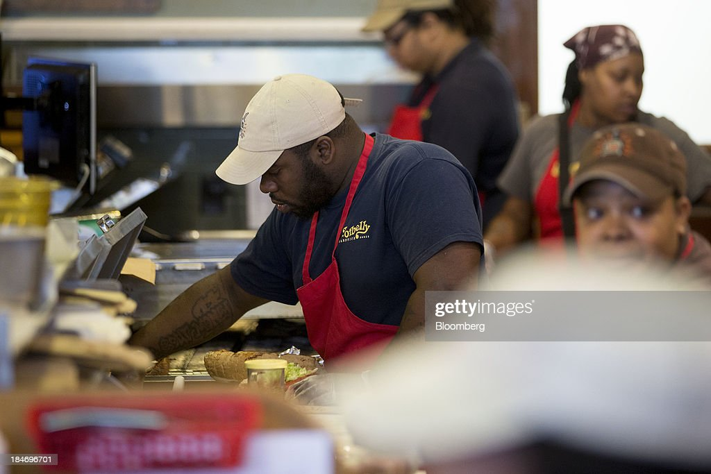 A Potbelly Corp. employee makes a sandwich a Potbelly Sandwich Shop in Washington, D.C., U.S., on Tuesday, Oct. 15, 2013. Potbelly Corp., the Chicago-based purveyor of made-to-order toasted sandwiches, held its initial public offering (IPO) on Oct. 4. Photographer: Andrew Harrer/Bloomberg via Getty Images