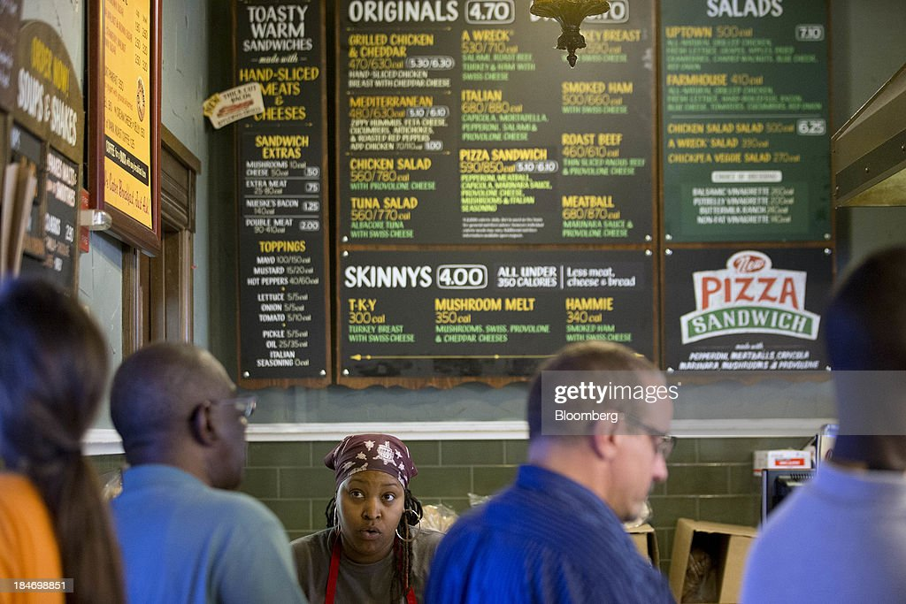 A Potbelly Corp. employee takes customer's orders at a Potbelly Sandwich Shop in Washington, D.C., U.S., on Tuesday, Oct. 15, 2013. Potbelly Corp., the Chicago-based purveyor of made-to-order toasted sandwiches, held its initial public offering (IPO) on Oct. 4. Photographer: Andrew Harrer/Bloomberg via Getty Images