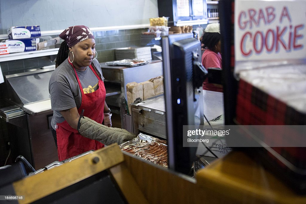 A Potbelly Corp. employee works at a Potbelly Sandwich Shop in Washington, D.C., U.S., on Tuesday, Oct. 15, 2013. Potbelly Corp., the Chicago-based purveyor of made-to-order toasted sandwiches, held its initial public offering (IPO) on Oct. 4. Photographer: Andrew Harrer/Bloomberg via Getty Images